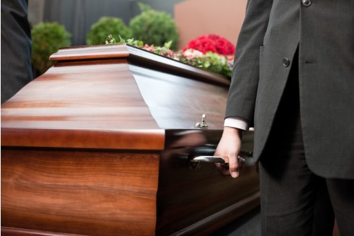 casket of a deceased loved one at a funeral